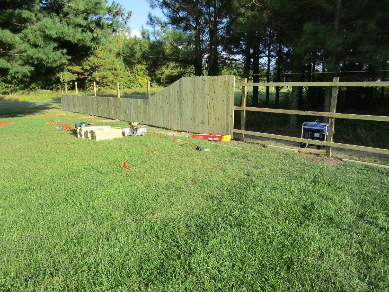 121_fence-in-progress-with-slope Wood - Forrest Fencing