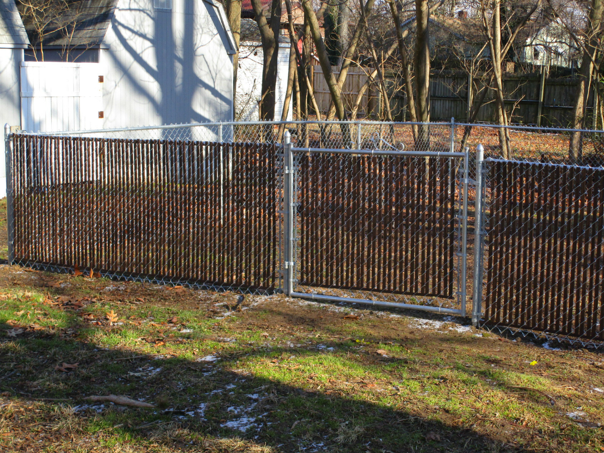 215_galvanized-chainlink-with-brown-privacy-slats Chainlink - Forrest Fencing